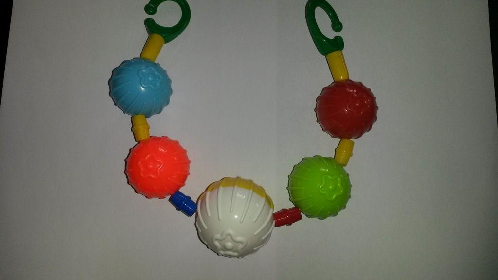 Barevné koule - zábrana na kočárek Hájková
